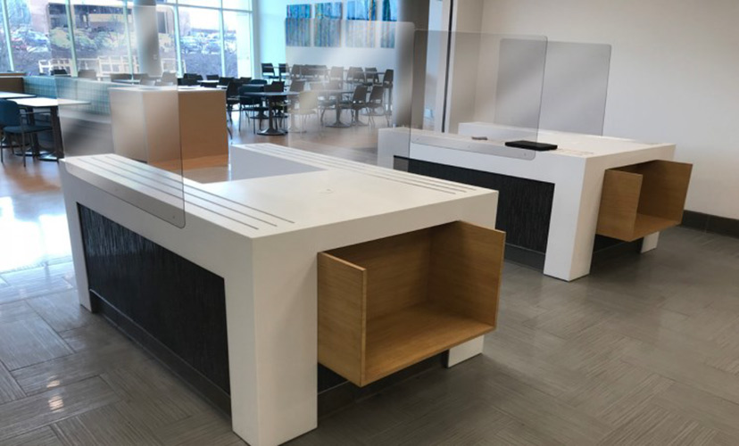 office desk with plexiglass breath guards