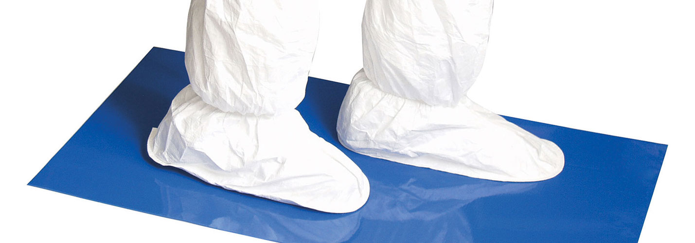 person with white booties on a blue mat