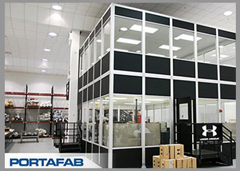 prefabricated office with boxes by front door